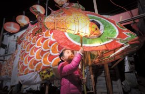 child with fish lantern in china