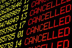 airport board showing cancelled flights