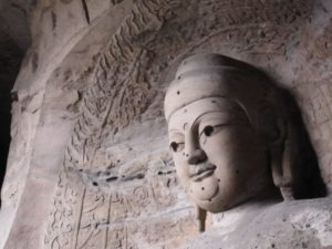 buddha head statue at yungang caves in china