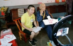 elderly man with young exercise trainer in china