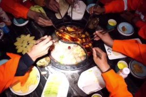 top view of sanitation workers eating hotpot