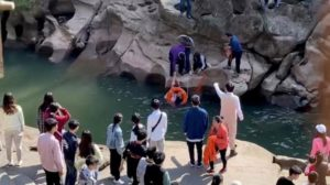 people helping girl and uk diplomat out of the water in china