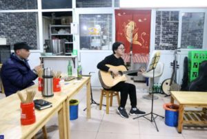 restaurant owner playing guitar in china