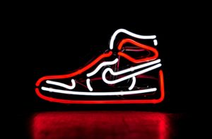 Brand Failure in China : neon light scultpure of nike trainers