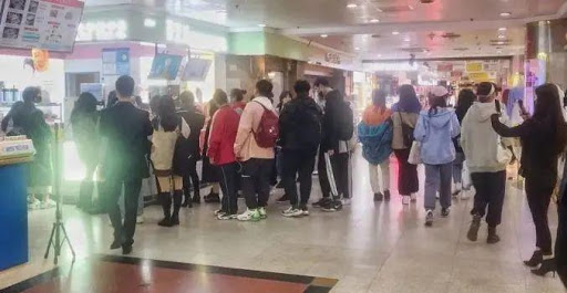 people queueing for milk tea at shop in shanghai