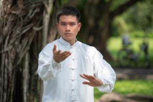front view of man performing tai chi