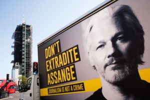 street billboard showing support to not extradite julian assange