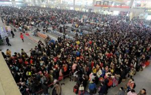 crowd of people travelling over chinese new year