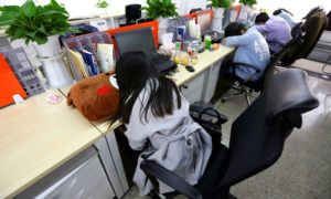 tech workers sleeping at desks in china