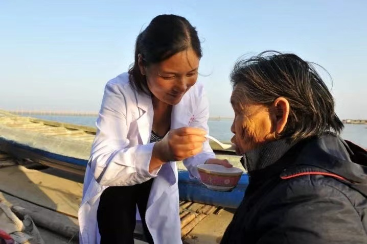doctor treating patient on boat in china