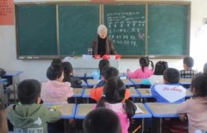 elderly teacher in primary school classroom in china