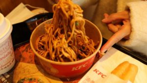 customer eating noodles at KFC china