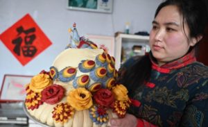 woman holding steamed flower bun in china
