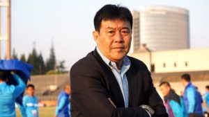 Chi Shangbin posing for picture on training ground