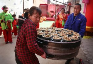 staff carrying dishes at wedding banquet in china