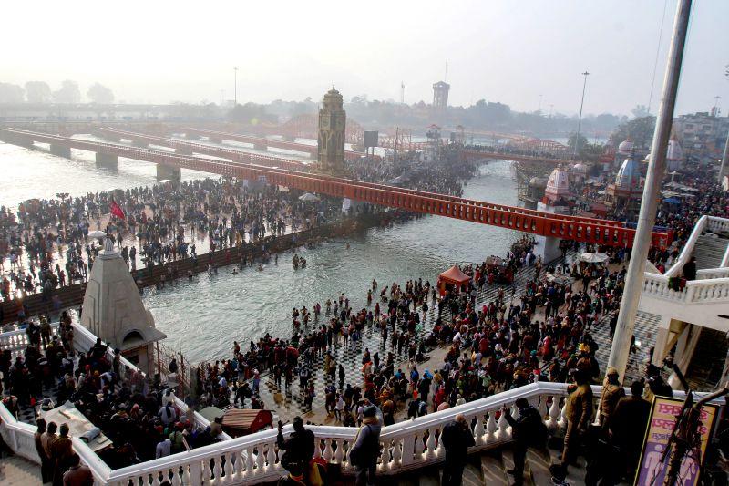 hindu pilgrims on ganges river for kumbh mela