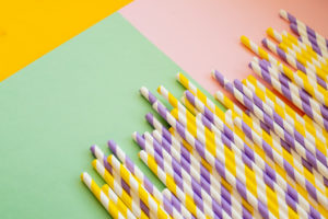 paper straws on colourful background
