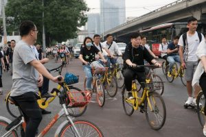 people riding share bikes in china