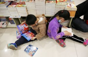 top view of two children sitting on the floor to read in china