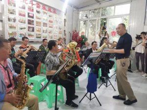 members of beidou village wind bad rehearsing in china c