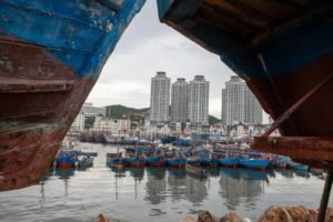 boats on water at wharf in dalian, china