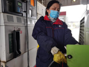 driver refuelling bus in shanghai, china