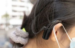 closeup view of girl with hearing aid