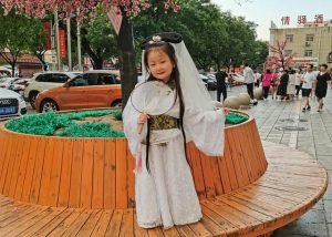 young girl dressed as madame white snake in china