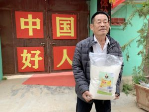 man carrying bag outside building in china
