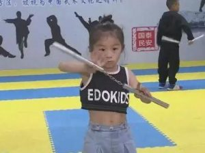 young girl practicing kung fu at gym in china