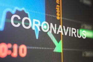coronavirus word on stocks and shares graph