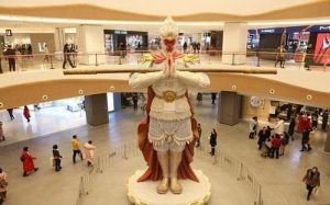 large monkey king statue in shopping mall hall