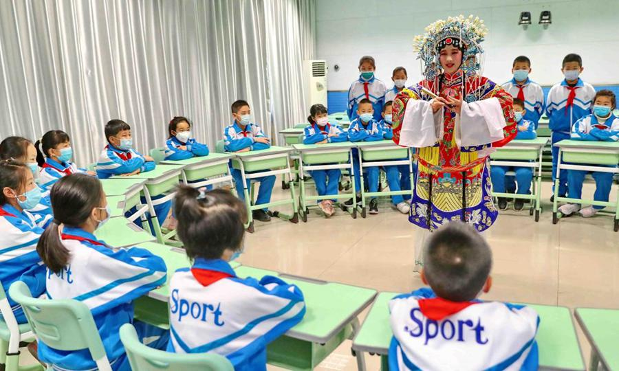 beijing opera performer giving demonstration in classroom