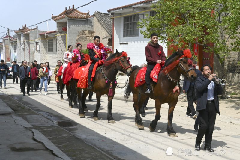 wedding procession on horses through chinese village