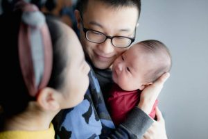 parents holding newborn baby in china