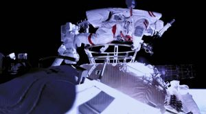side view of chinese astronaut on space walk