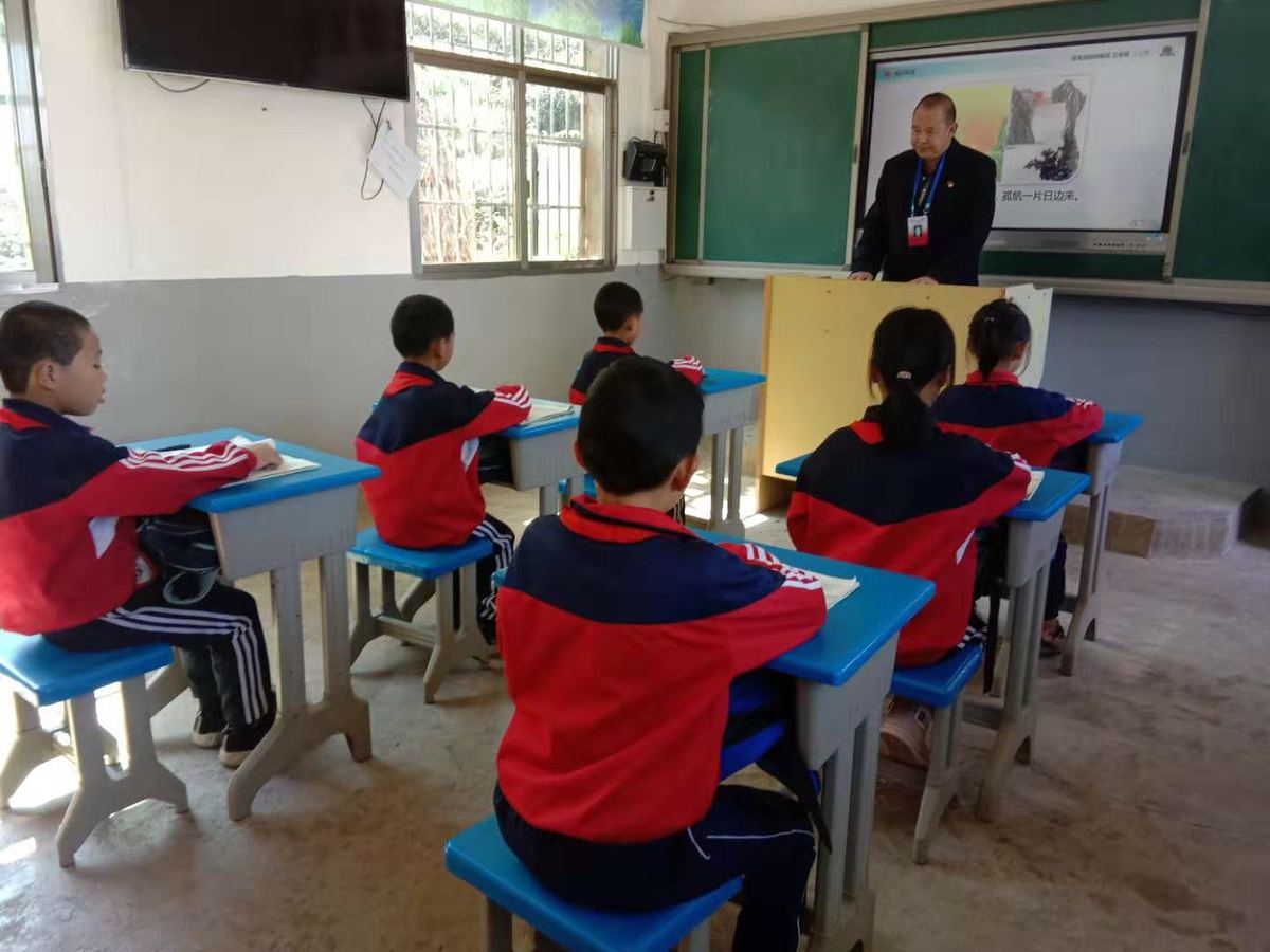 students and teacher in class at village school in china