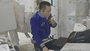 chinese astronaut eating aboard chinese space station