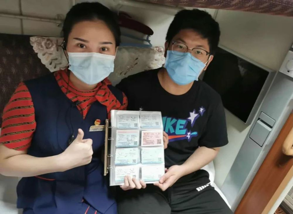 young boy with woman posing for picture with train ticket collection