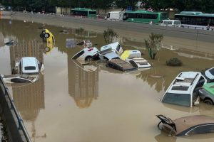 cars submerged in flood waters in henan, china