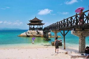 tourists on beach in sanya china