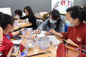 art students painting at night art school in shanghai