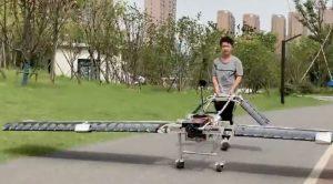teenage boy wheeling home-made drone in china