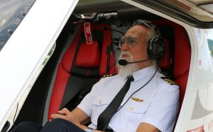 front and side view of elderly pilot in plane in china