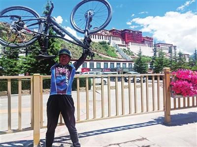 elderly cyclist raising bike above head in lhasa, tibet