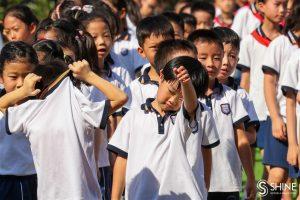 shanghai school children outside on hot day