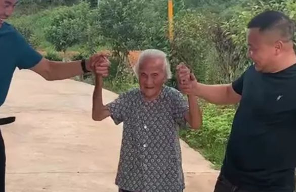 grandmother posing for picture with family in china