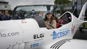 teenage pilot Zara Rutherford waving from cockpit before round the world trip