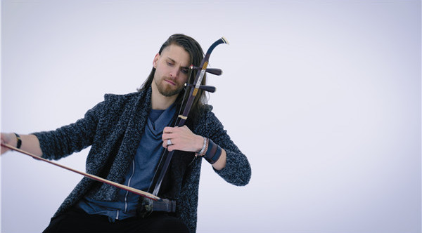 french musician playing chinese instrument erhu