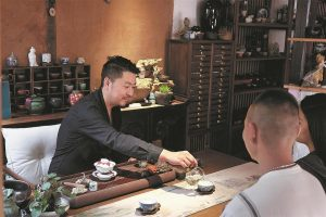 guesthouse owner serving tea to guests in china